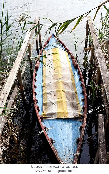 Boat tied in the waters of the Jucar river, Cullera,