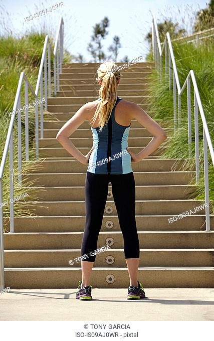 Woman standing at base of stairs