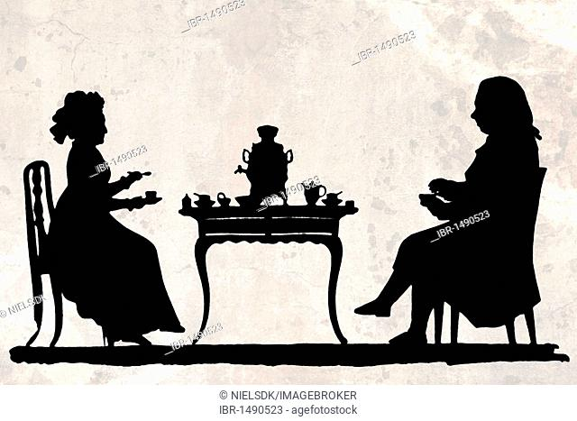 Hand made paper-cut of man and woman drinking tea