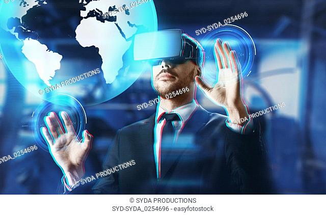 businessman in virtual reality headset with earth