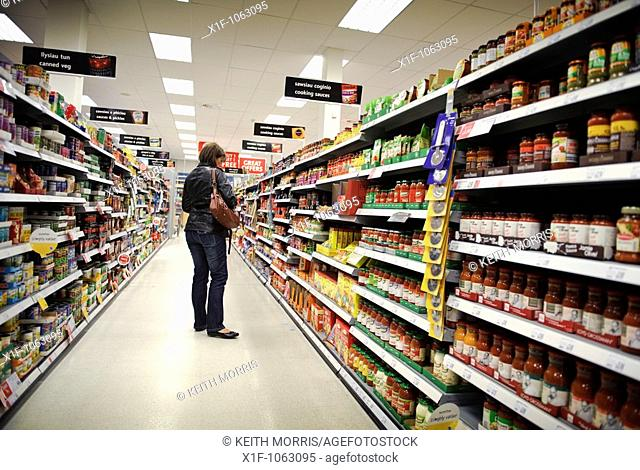 A woman shopping on her own in a Somerfield supermarket, UK