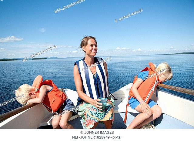 Mother with son and daughter on boat