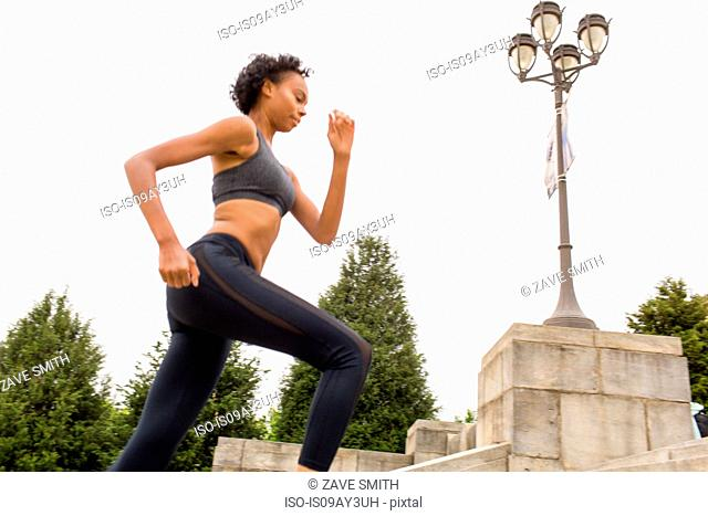 Woman wearing sports clothing running in city