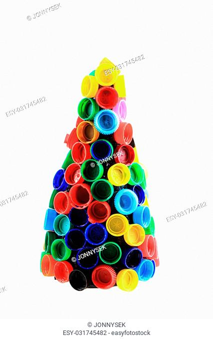 chriostmas tree from color plastic caps isolated on the white background