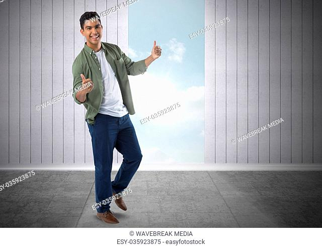 Businessman giving thumbs up with sky opening