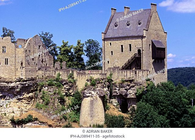 Castle ruins stand over Larochette, a popular tourist town in central Luxembourg