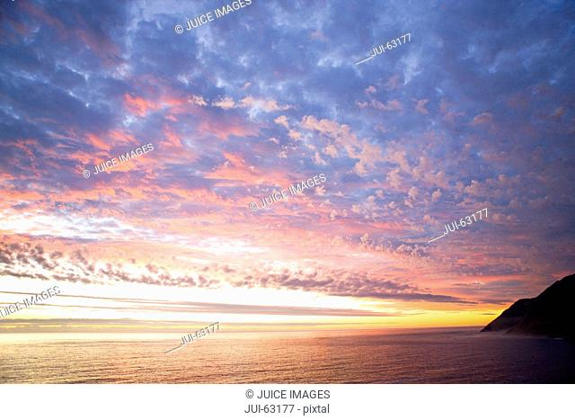 Scenic view of coastline and sunset