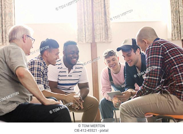 Men talking in group therapy