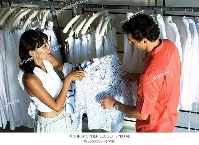 young couple shopping at store