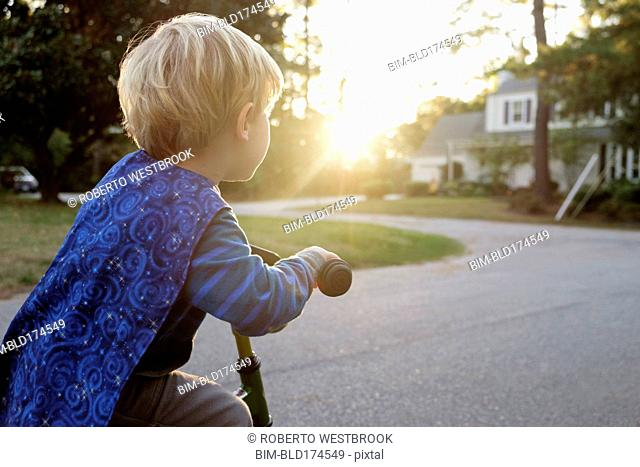 Caucasian boy riding bicycle