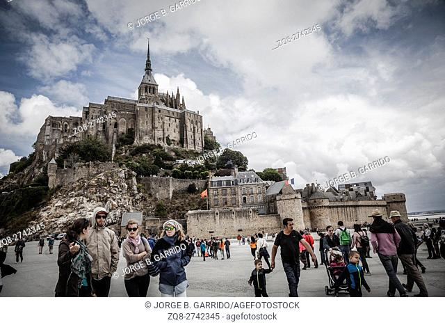 People visiting Mont Saint Michel monastery, Brittany, France