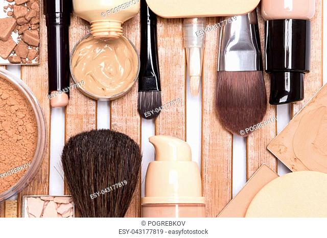 Concealer, primer, foundation, cosmetic powder, make up brushes and sponges. Makeup products to even out skin tone and complexion
