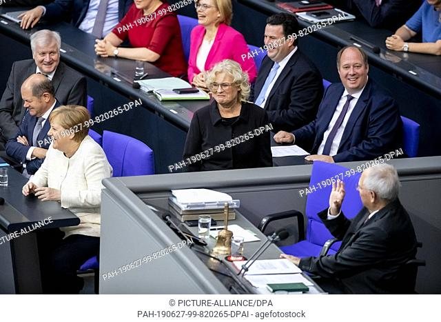 27 June 2019, Berlin: Christine Lambrecht (SPD, M), Federal Minister of Justice, is welcomed in the Bundestag plenum before being sworn in as Federal Minister...