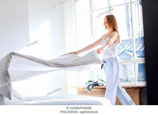 Woman making the bed