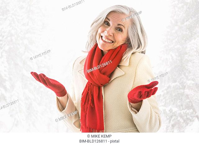 Portrait of shrugging Caucasian woman in warm clothing