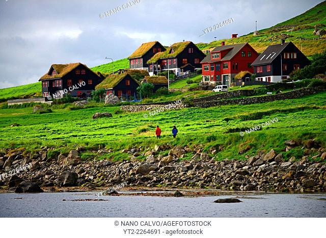 Couple walking in Kirkjubøur, Faroe Islands