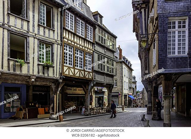 DINAN, BRITAN, FRANCE - JUNE -2015: Place des Merciers, neuralgic center of the medieval city of Dinan where tourists buy in their shops on June 22, 2015