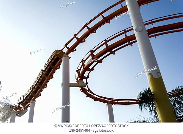 Roller coaster ride going on at the rails on the Santa Monica entertainment park, California, USA