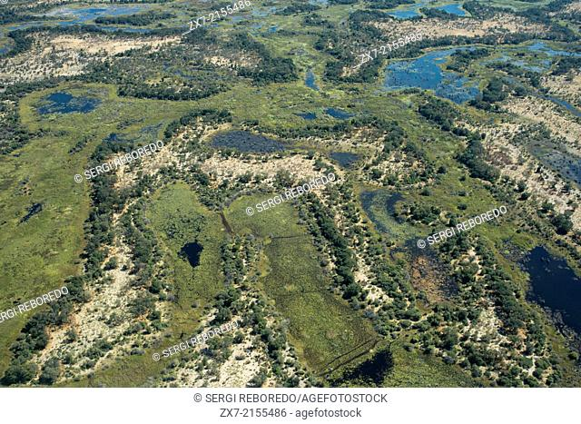 Aerial views from Camp Khwai River Lodge by Orient Express in Botswana , within the Moremi Game Wildlife Reserve and the city of Maun