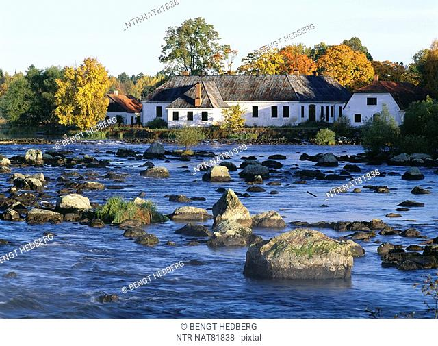 Houses by a river, Dalälven, Sweden