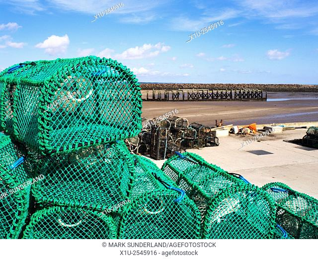 New Lobster Pots on the Quayside at Amble Harbour Amble by the Sea Northumberland England