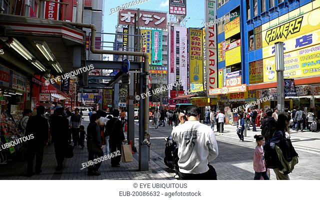 Akihabara electric city, near the train station, crowds, jumble of signs