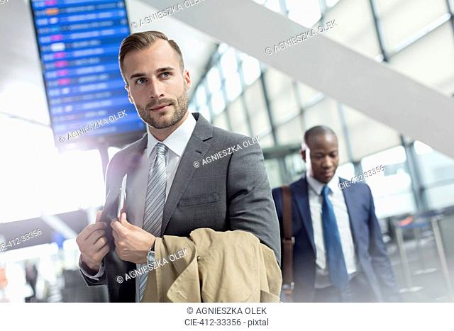 Businessman in airport concourse