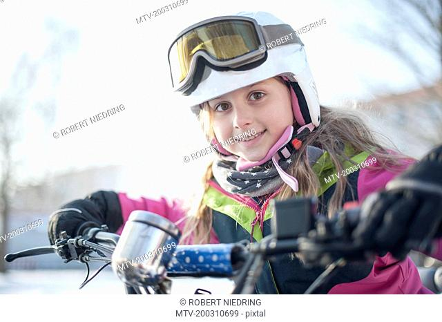 Portrait of girl wearing helmet and goggles