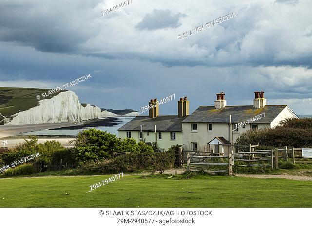 Late summer afternoon at Coastguard Cottages and Seven Sisters Cliffs in East Sussex, England. South Downs National Park