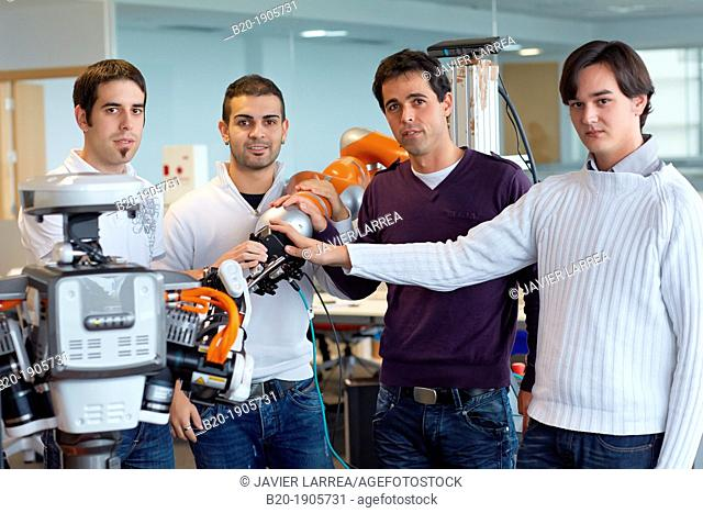 Researchers working with Robots  HIRO robot, Humanoid robot for automotive assembly tasks in collaboration with people and and LWR robot