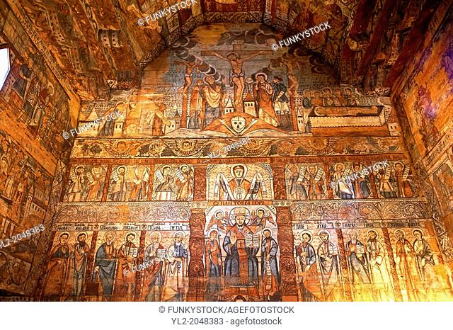 Naive folk christian frescoes in the interior of the Orthodox Wooden Church of the Church on The Hill, Maramures, Northern Transylvania, Romania