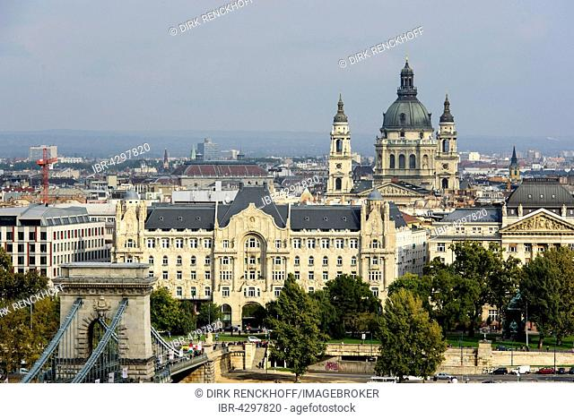 View from Buda to Pest riverbank with Chain Bridge, Gresham Palace and St. Stephan, Budapest, Hungary