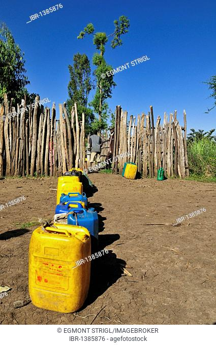 Canisters for drinking water lined up in front of a water well, Rift Valley, Oromia, Ethiopia, Africa