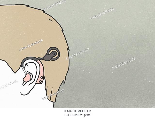 Cropped image of man wearing hearing aid against colored background