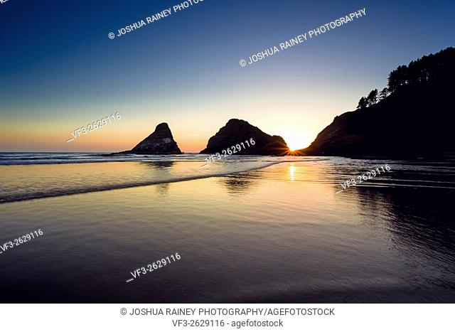 Heceta Head Beach located on the beautiful Oregon Coast at sunset on a clear Summer evening near dusk