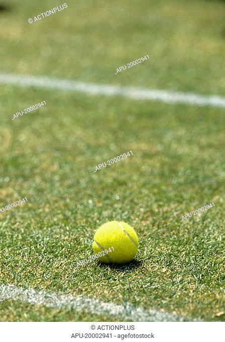 Tennis ball on a grass court