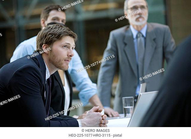 Businessmen listening attentively in meeting