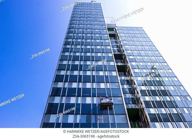 Window cleaner at work at the The Zenith Tower in Brussels, Europe