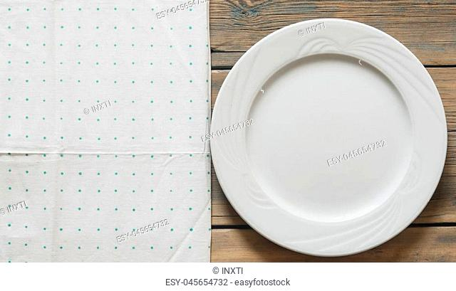 Closeup empty white plate on colorful polka dot background.Top view with copy space