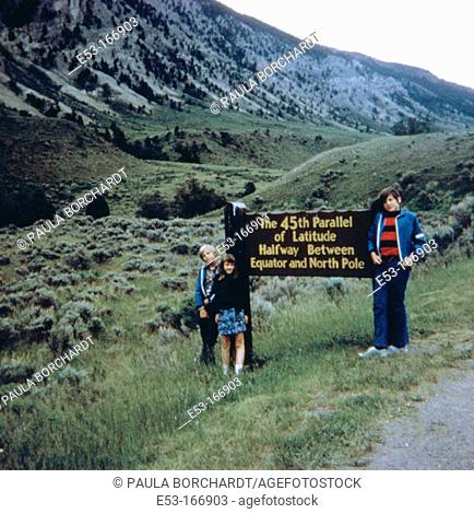 Children at 45th Parallel. Yellowstone National Park. Wyoming. USA