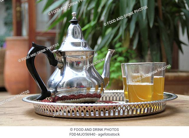 Mint tea with kettle in a Moroccan courtyard