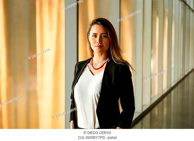Young woman in corridor