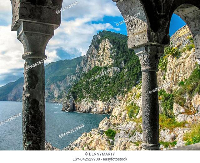 Beautiful shoreline scenery of Cinque Terre view from the columns of famous gothic Church of St. Peter, Chiesa di San Pietro, in the town of Porto Venere