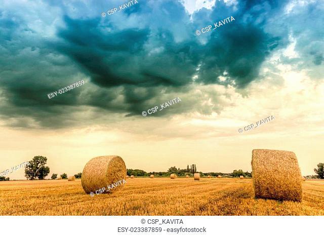 Straw bales with dramatic sky