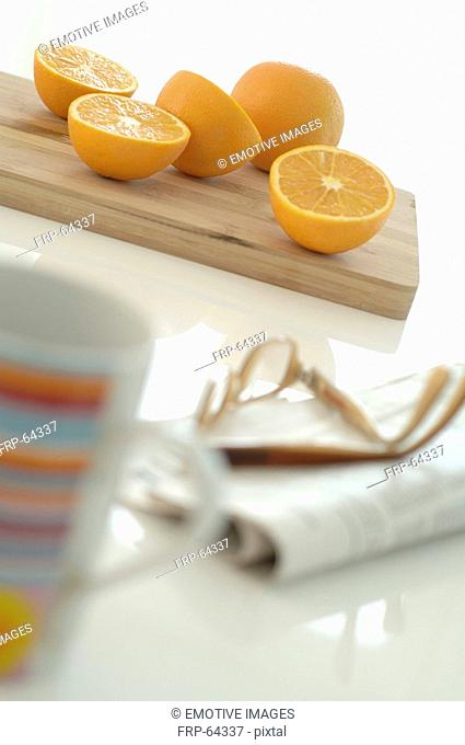 oranges and a newspaper