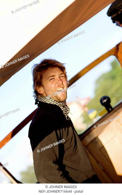 A laughing man on a motorboat, Sweden