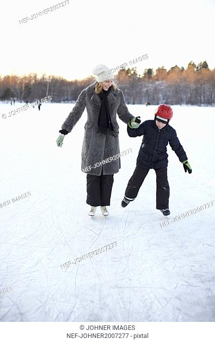 Mother with son ice skating