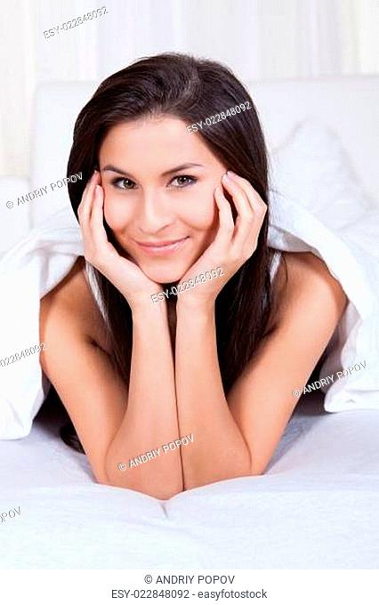 Smiling woman resting her chin on her hands
