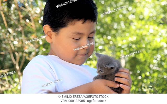 Little kid with a kitten