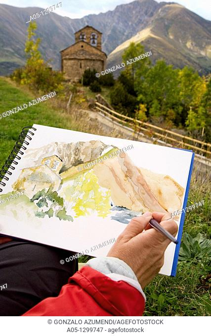 Man painting a watercolor  Chapel of Sant Quirze  Durro  Boi - Taull Valley. Alta Ribagorça, Lleida province, Catalonia, Spain